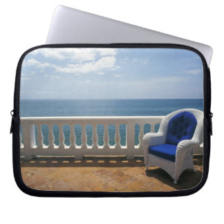 Puerto Rico. Wicker chair and tiled terrace at Laptop Sleeves