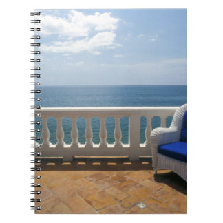 Puerto Rico. Wicker chair and tiled terrace at Spiral Notebooks