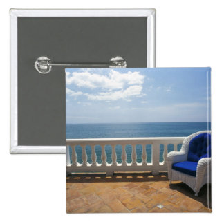 Puerto Rico. Wicker chair and tiled terrace at Pinback Button