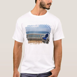 Puerto Rico. Wicker chair and tiled terrace at T-Shirt