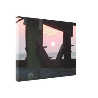 Puesta del sol a través del embarcadero - isla del impresión en lona estirada