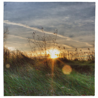 Puesta del sol a través del vidrio servilleta de papel