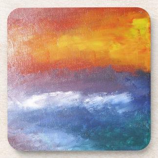 Puesta del sol abstracta de la playa posavaso