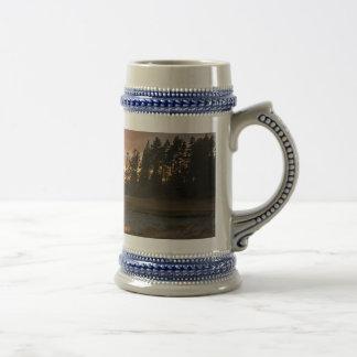 Puesta del sol acadiense tazas de café