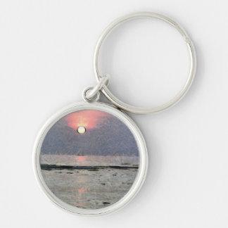 Puesta del sol acuosa llavero redondo plateado