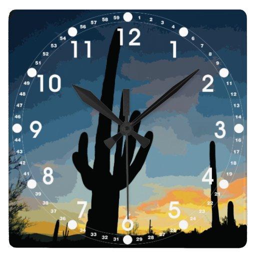 Puesta del sol al sudoeste del cactus del Saguaro  Relojes De Pared