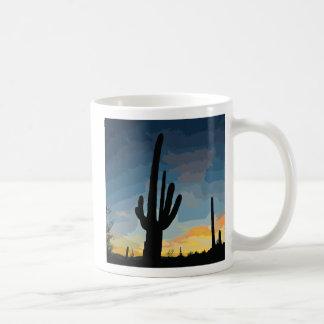 Puesta del sol al sudoeste del cactus del Saguaro  Tazas