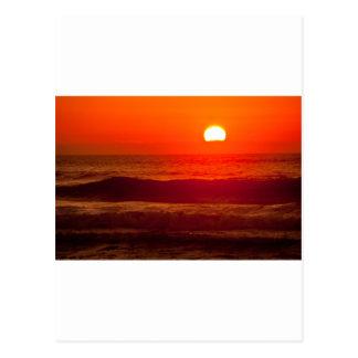 Puesta del sol anaranjada en la playa de Horsfall, Postal