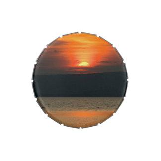Puesta del sol anaranjada magnífica en frascos de dulces