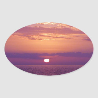Puesta del sol anaranjada púrpura de la Florida Pegatina Ovalada