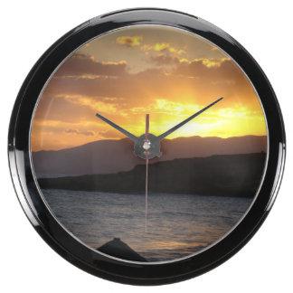 Puesta del sol relojes pecera