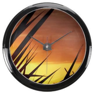 Puesta del sol reloj aquavista