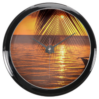 Puesta del sol relojes acuario