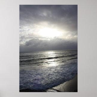 Puesta del sol azul plateada póster