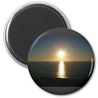 Puesta del sol Bigbury en el mar Iman
