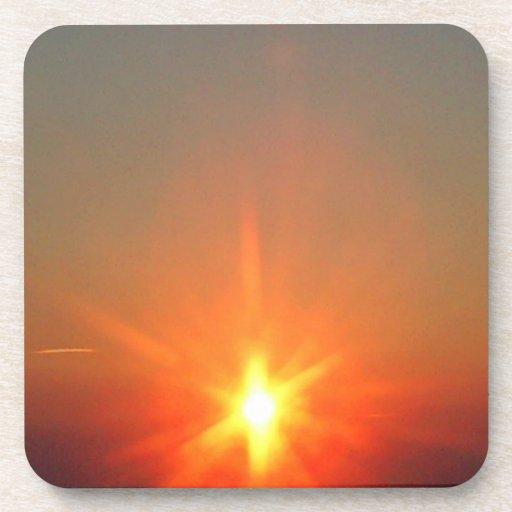 Puesta del sol borrosa posavasos de bebidas