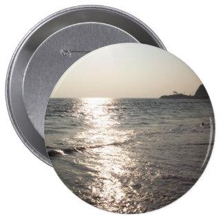 Puesta del sol, botón enorme