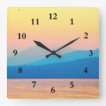 Puesta del sol ciánica y de color salmón reloj de pared