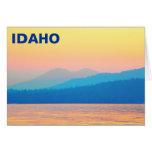 Puesta del sol ciánica y de color salmón tarjeta de felicitación