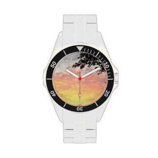 Puesta del sol colorida reloj