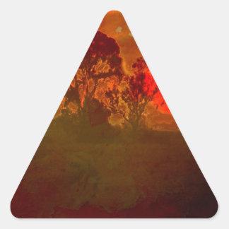 Puesta del sol con el árbol pegatina triangular