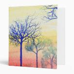 Puesta del sol con los árboles azules