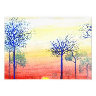 Puesta del sol con los árboles azules foto
