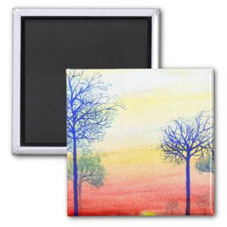 Puesta del sol con los árboles azules imán cuadrado