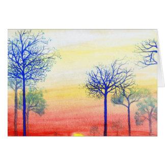 Puesta del sol con los árboles azules tarjeta pequeña
