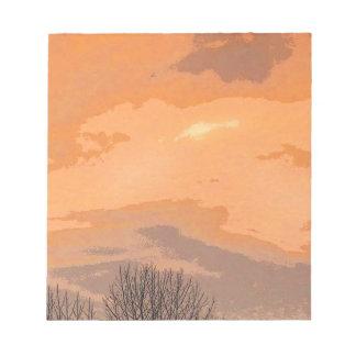 Puesta del sol con los árboles desnudos bloc de notas