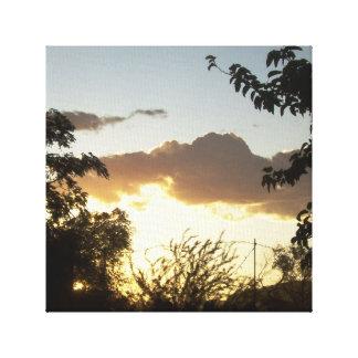 Puesta del sol con los árboles impresión en lienzo