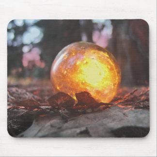 Puesta del sol de cristal del flotador llenada alfombrilla de raton