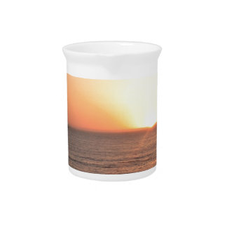 Puesta del sol de la costa del norte jarra de beber