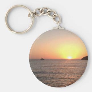 Puesta del sol de la costa del norte llaveros