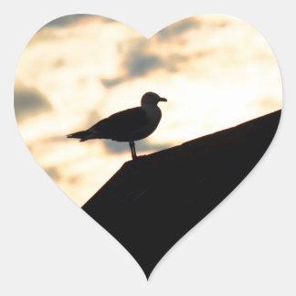 Puesta del sol de la gaviota colcomanias corazon