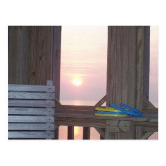 Puesta del sol de la playa con las herraduras tarjeta postal
