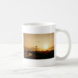 Puesta del sol de la playa de Coney Island Taza