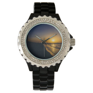 Puesta del sol de la playa de Dubai Reloj