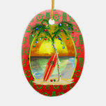 Puesta del sol de la playa del navidad adorno ovalado de cerámica