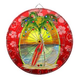 Puesta del sol de la playa del navidad tabla dardos