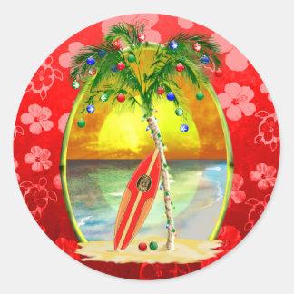Puesta del sol de la playa del navidad pegatina redonda