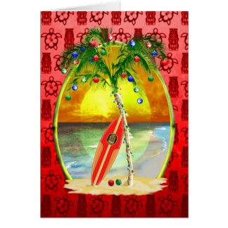 Puesta del sol de la playa del navidad tarjetón