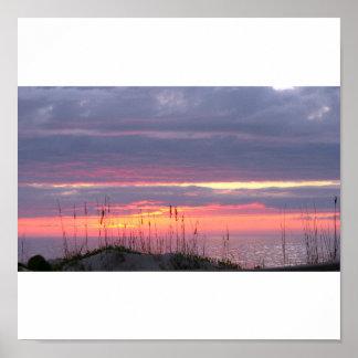 Puesta del sol de la playa póster