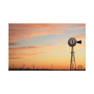Puesta del sol de la silueta del molino de viento lona estirada galerias