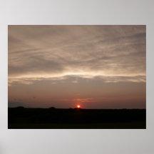 Puesta del sol de la tormenta de la pradera impresiones