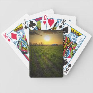 Puesta del sol de las tierras de labrantío cartas de juego