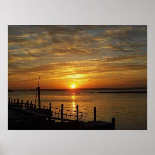 Puesta del sol de piedra del puerto impresiones