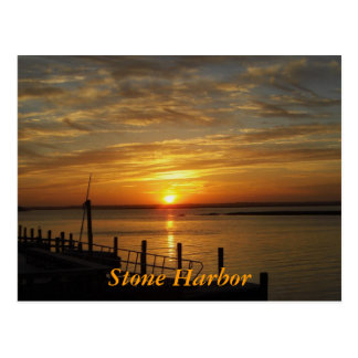 Puesta del sol de piedra del puerto postales