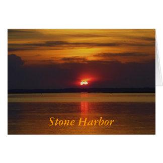 Puesta del sol de piedra del puerto tarjeta de felicitación