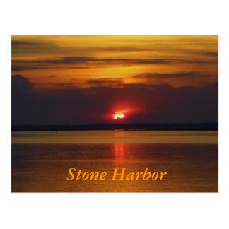 Puesta del sol de piedra del puerto tarjetas postales